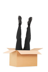 Vertical shot of male legs sticking out of a box