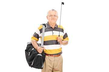 Mature man holding a golf club and a sports bag
