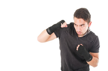 handsome latin fighter wearing black clothes training
