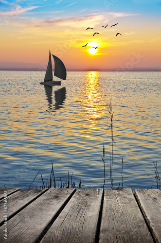 Fotobehang Een Hoekje om te Dromen navegando hacia el sol naciente