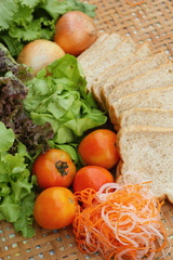 Fresh vegetables salad with whole wheat bread.