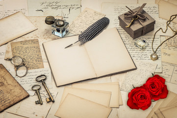 diary book, old love letters and red rose flowers