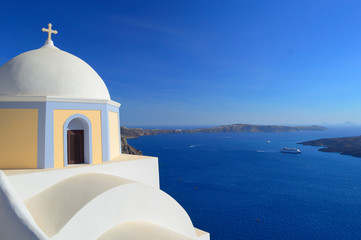 Beautiful church on the caldera and ships in the bay, Fira, Sant