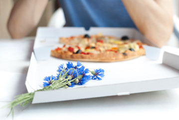 Eating pizza - Bunch of cornflowers on a pizza box