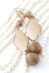 Ear rings on pearl necklace