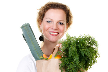 woman with a bag full of vegetables