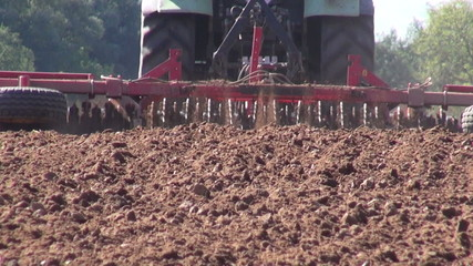 agriculture tractor cultivated farmland soil