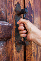 Door with a hand on handle