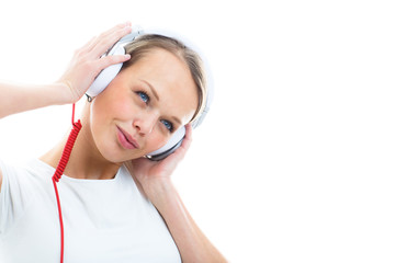 Pretty, young woman listening to her favorite music