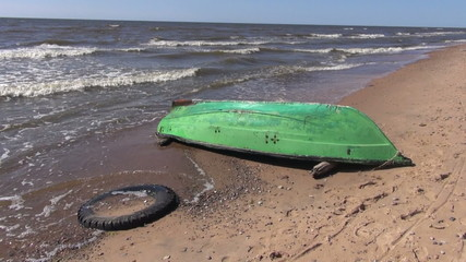 retro wooden green boat on empty sea resort beach