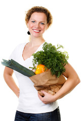 friendly woman with a bag full of vegetables