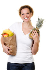 woman with a bag full of fruits