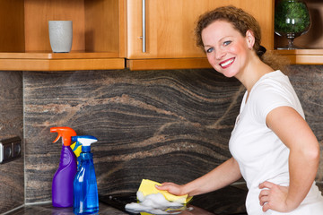 woman cleans the kitchen