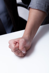 Close-up of woman's decided hand