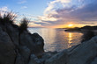 Rocks, sand, sea, beach with a small cave at sunset, Sithonia