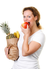 woman eats an apple