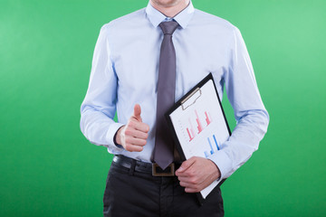 Man with bar chart showing okay gesture