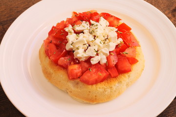 Bruschetta with tomatoes, oregano and feta cheese