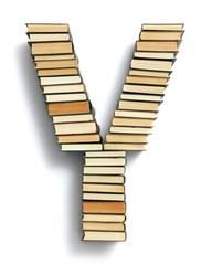 Letter Y formed from the page ends of books