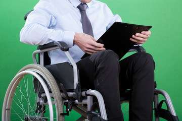Disabled businessman with documents