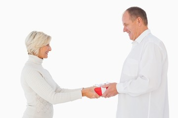 Blonde woman passing gift to her partner