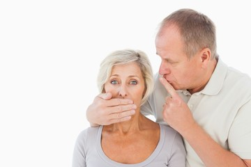 Man silencing his fearful partner