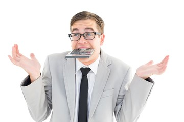Geeky shrugging businessman biting calculator