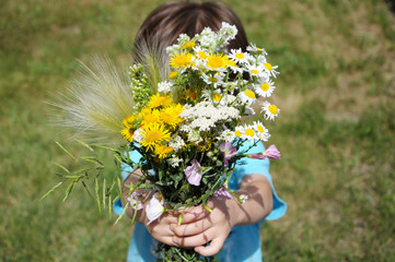 Boy bringning flowers