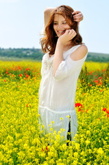 beautiful girl on rapeseed field