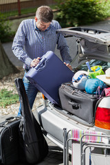 Man during preparation for family travel