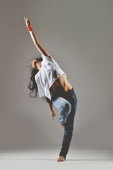 beautiful young woman dancing, studio shot