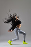 Fototapety beautiful young woman dancing, studio shot