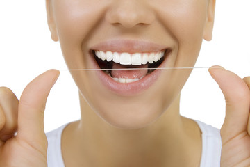 Woman and teeth floss