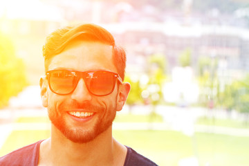 Young happy man with sunglasses