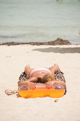 Girl sunbathing on air mattress