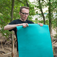 Man packing the tourist mat