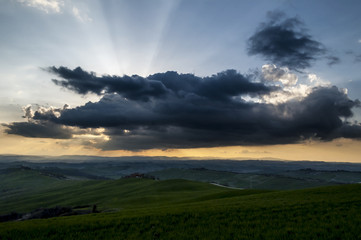 Crete Senesi, sunset and clouds on the plains