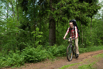 Man riding a bike in the forest road