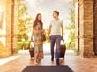 Leinwanddruck Bild - Young couple standing at hotel corridor upon arrival