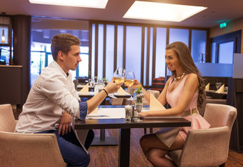 Loving couple toasting a restaurant