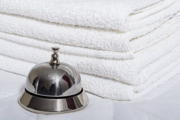 Room service bell and towels.