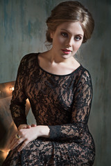 Beauty model in black lace dress.