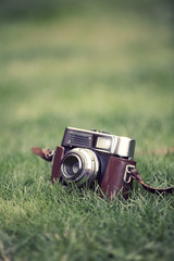 film camera on grass