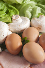 Fresh eggs, mushrooms, ham and lettuce. Fresh ingredients.