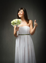 girl with wedding dress thumbs up