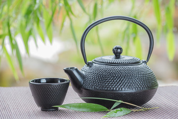 green tea bowl cup with bamboo as background