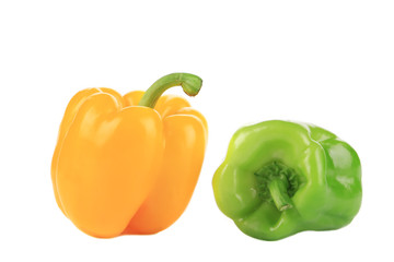 Two green and yellow sweet bell peppers.