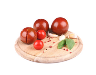 Tomatoes with garlic and basil on platter.