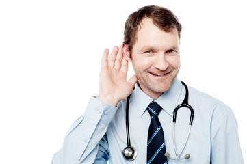Physician listening with his hand on an ear