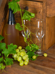 Yellow grape, champagne and wineglasses